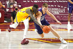 Minnesota's Both Gach, left, and Northwestern's Miller Kopp chase the ball in the second half of an NCAA college basketball game, Thursday, Feb. 25, 2021, in Minneapolis. (AP Photo/Jim Mone)