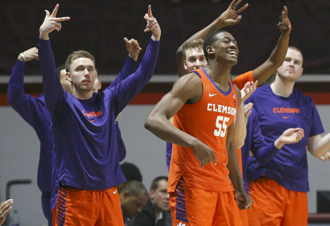 Clemson players celebrate a 3-point basket against Virginia Tech during the first half of an NCAA college basketball game Wednesday, March 4, 2020, in Blacksburg, Va. (Matt Gentry/The Roanoke Times via AP)