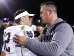 Notre Dame's Ian Book, left, is congratulated by Northwestern's coach Pat Fitzgerald after their NCAA college football game Saturday, Nov. 3, 2018, in Evanston, Ill. (AP Photo/Jim Young)
