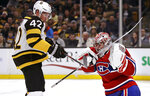 Montreal Canadiens goaltender Carey Price, right, makes a save against Boston Bruins right wing David Backes (42) during the second period of an NHL hockey game in Boston, Monday, Jan. 14, 2019. (AP Photo/Charles Krupa)