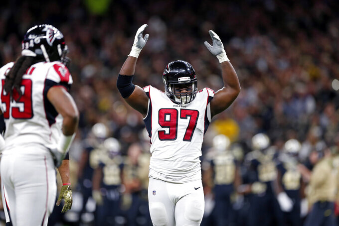 Atlanta Falcons defensive tackle Grady Jarrett (97) reacts between plays in the first half of an NFL football game against the New Orleans Saints in New Orleans, Sunday, Nov. 10, 2019. (AP Photo/Rusty Costanza)