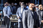 """People leave the funeral services for the late Marcel Theo Hall, aka """"Biz Markie"""" at the Patchogue Theater for the Performing Arts on Monday Aug. 2, 2021 in Patchogue, NY. (Alejandra Villa Loarca/Newsday via AP)"""