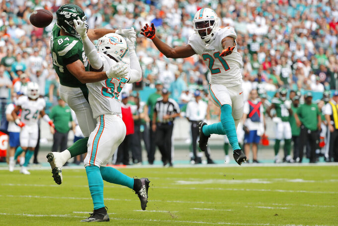 Miami Dolphins outside linebacker Jerome Baker (55) breaks up a pass intended for New York Jets tight end Ryan Griffin (84) during the first half of an NFL football game, Sunday, Nov. 3, 2019, in Miami Gardens, Fla. (AP Photo/Wilfredo Lee)