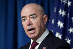 Homeland Security Secretary Alejandro Mayorkas updates reporters on the effort to resettle vulnerable Afghans in the United States, in Washington, Friday, Sept. 3, 2021. (AP Photo/J. Scott Applewhite)