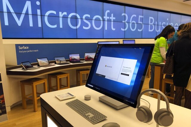 In this Tuesday, Jan. 28, 2020, photo a Microsoft computer is among items displayed at a Microsoft store in suburban Boston. Microsoft reports financial results on Wednesday, Jan. 29, 2020. (AP Photo/Steven Senne)