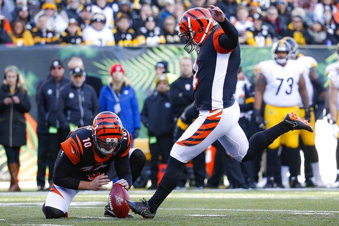 Cincinnati Bengals kicker Randy Bullock, right, kicks a field goal during the second half an NFL football game against the Pittsburgh Steelers, Sunday, Nov. 24, 2019, in Cincinnati. (AP Photo/Frank Victores)