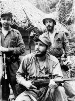 FILE - In this March 14, 1957 file photo, Fidel Castro, the young anti-Batista guerrilla leader, center, is seen with his brother Raul Castro, left, and Camilo Cienfuegos, while operating in the mountains of eastern Cuba. Fidel led his scruffy young guerrillas to an improbable victory in 1959, embraced Soviet-style communism and defied the power of 10 U.S. presidents, with Raul always at his side. (AP Photo/Andrew St. George, File)