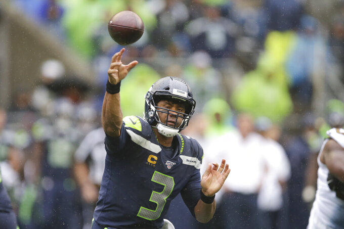 Seattle Seahawks quarterback Russell Wilson throws against the New Orleans Saints during the first half of an NFL football game Sunday, Sept. 22, 2019, in Seattle. (AP Photo/Scott Eklund)