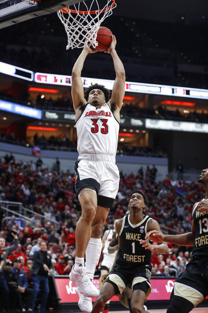 Louisville forward Jordan Nwora (33) dunks during the second half of the team's NCAA college basketball game against Wake Forest on Wednesday, Feb. 5, 2020, in Louisville, Ky. Louisville won 86-76. (AP Photo/Wade Payne)