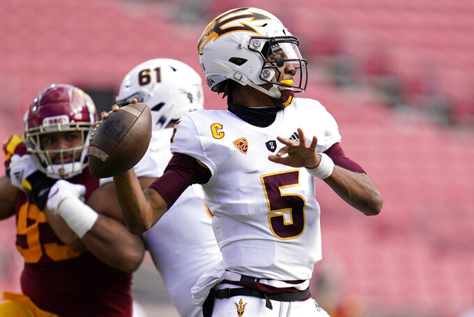 Arizona State quarterback Jayden Daniels (5) throws a pass against Southern California during the first half of an NCAA college football game Saturday, Nov. 7, 2020, in Los Angeles. (AP Photo/Ashley Landis)
