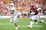 Texas quarterback Sam Ehlinger (11) runs after making a catch against Oklahoma during the first half of an NCAA college football game at the Cotton Bowl, Saturday, Oct. 6, 2018, in Dallas. (AP Photo/Cooper Neill)