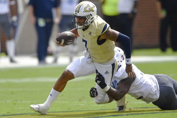 Georgia Tech quarterback Lucas Johnson (7) runs against The Citadel during the first half of an NCAA college football game, Saturday, Sept. 14, 2019, in Atlanta. (AP Photo/Mike Stewart)