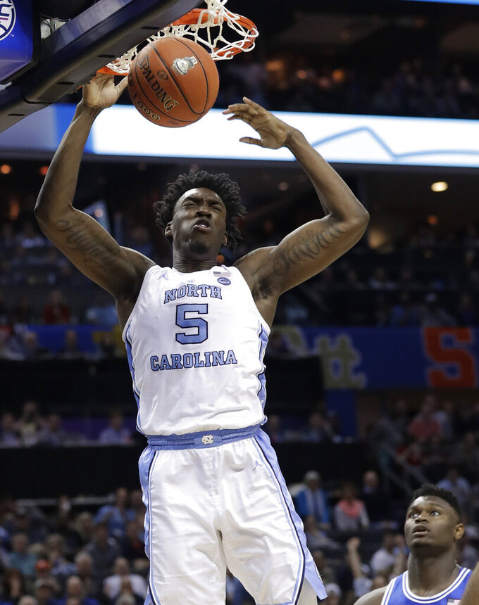North Carolina's Nassir Little (5) dunks against Duke during the second half of an NCAA college basketball game in the Atlantic Coast Conference tournament in Charlotte, N.C., Friday, March 15, 2019. (AP Photo/Chuck Burton)