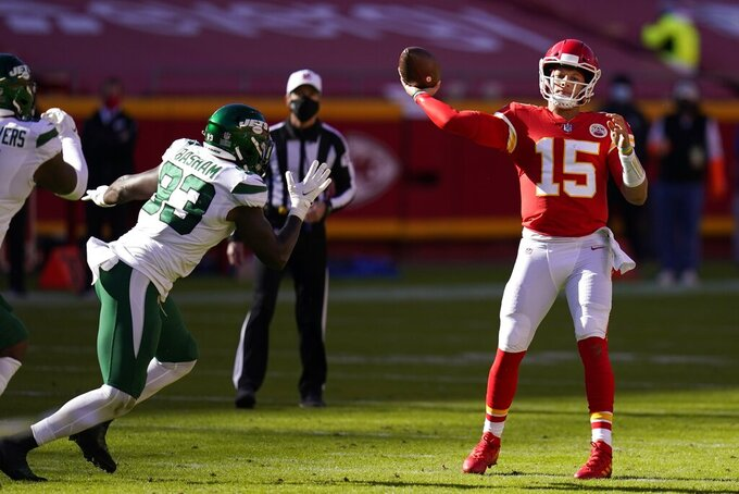 New York Jets linebacker Tarell Basham (93) pressures as Kansas City Chiefs quarterback Patrick Mahomes (15) throws a pass in the second half of an NFL football game on Sunday, Nov. 1, 2020, in Kansas City, Mo. (AP Photo/Jeff Roberson)