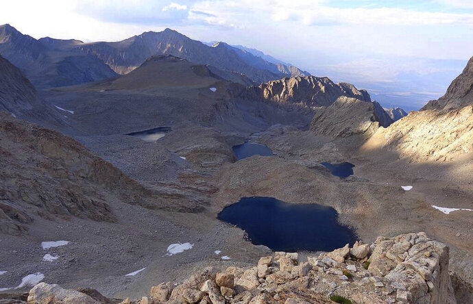 This undated photo provided by the Inyo County Sheriff's Department shows 6th lake below Mount Williamson where authorities say the skeletal remains of a person were discovered on Oct. 7, 2019 beneath the state's second-highest peak. The body was discovered by climbers last week who saw what appeared to be a bone beneath boulders. High winds prevented a helicopter from retrieving the body until Wednesday, Oct. 16, 2019, Roper says the body may have been there for decades based on its condition. (Inyo Sheriff's Department via AP)