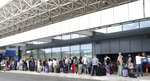 British tourists wait in a queue at the Ioannis Kapodistrias Airport in Corfu island, northwestern Greece, Monday, Sept. 23, 2019. Hundreds of thousands of travellers were stranded across the world Monday after British tour company Thomas Cook collapsed, immediately halting almost all its flights and hotel services and laying off all its employees. (Stamatis Katopodis/InTime News via AP)