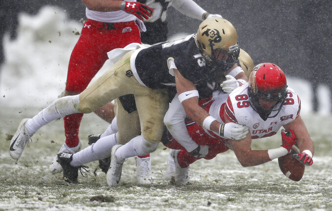 Utah tight end Cole Fotheringham, right, is tackled by Colorado defensive back Kyle Trego in the first half of an NCAA college football game Saturday, Nov. 17, 2018, in Boulder, Colo. (AP Photo/David Zalubowski)