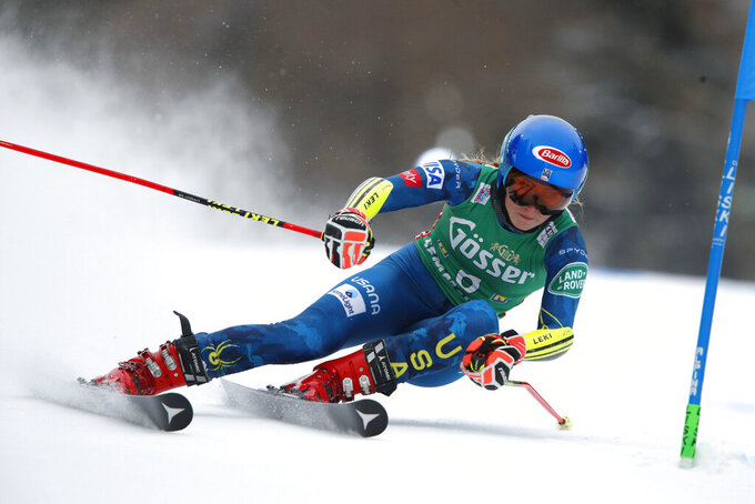 United States' Mikaela Shiffrin speeds down the course during an alpine ski, women's World Cup giant slalom, in Semmering, Austria, Monday, Dec. 28, 2020. (AP Photo/Gabriele Facciotti)