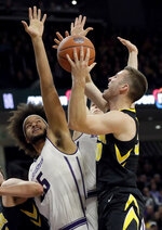 Iowa guard Connor McCaffery, right, drives to the basket against Northwestern center Barret Benson, left, and guard Ryan Greer during the first half of an NCAA college basketball game Wednesday, Jan. 9, 2019, in Evanston, Ill. (AP Photo/Nam Y. Huh)