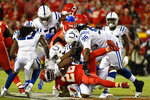 Kansas City Chiefs running back Damien Williams (26) is tackles by Indianapolis Colts defenders, including defensive end Denico Autry (96), during the first half of an NFL football game in Kansas City, Mo., Sunday, Oct. 6, 2019. (AP Photo/Ed Zurga)