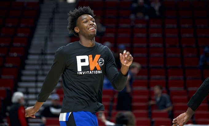 Memphis center James Wiseman warms up for the team's NCAA college basketball game against Oregon in Portland, Ore., Tuesday, Nov. 12, 2019. (AP Photo/Craig Mitchelldyer)