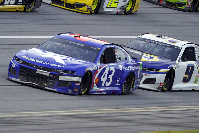 Bubba Wallace (43) and Chase Elliott (9) drive during the NASCAR Cup Series auto race at Talladega Superspeedway on Sunday, Oct. 4, 2020, in Talladega, Ala. (AP Photo/John Bazemore)