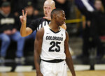Colorado guard McKinley Wright IV, front, reacts as he is called for a foul against Oregon State in the second half of an NCAA college basketball game Sunday, Jan. 5, 2020, in Boulder, Colo. (AP Photo/David Zalubowski)