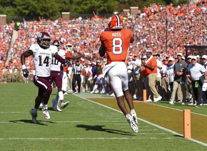 Clemson's Justyn Ross (8) catches a pass for a touchdown while defended by Texas A&M's Keldrick Carper during the first half of an NCAA college football game Saturday, Sept. 7, 2019, in Clemson, S.C. (AP Photo/Richard Shiro)