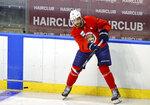 Florida Panthers defenseman Aaron Ekblad passes the puck during an NHL hockey training camp Thursday, Sept. 23, 2021, in Sunrise, Fla. (David Santiago/Miami Herald via AP)