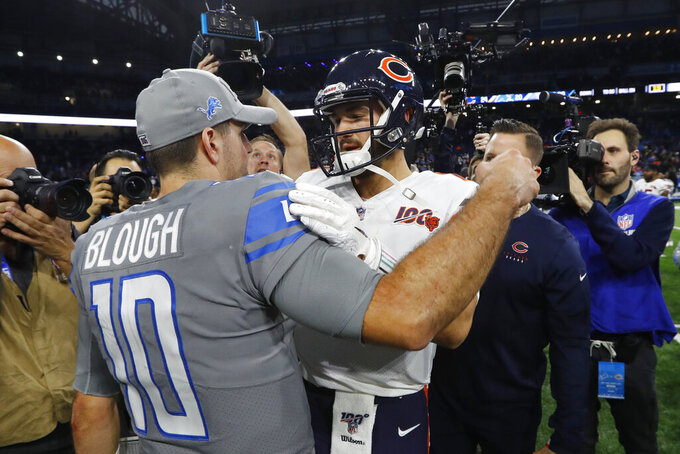 Detroit Lions quarterback David Blough, left, meets with Chicago Bears quarterback Mitchell Trubisky after an NFL football game, Thursday, Nov. 28, 2019, in Detroit. (AP Photo/Paul Sancya)