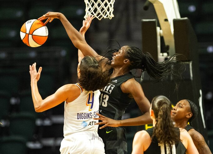 Seattle Storm's Ezi Magbegor (13) gets a clean block on a shot by Phoenix Mercury's Skylar Diggins-Smith in the first quarter of a WNBA basketball game Friday, Sept. 17, 2021, in Everett, Wash. (Dean Rutz/The Seattle Times via AP)