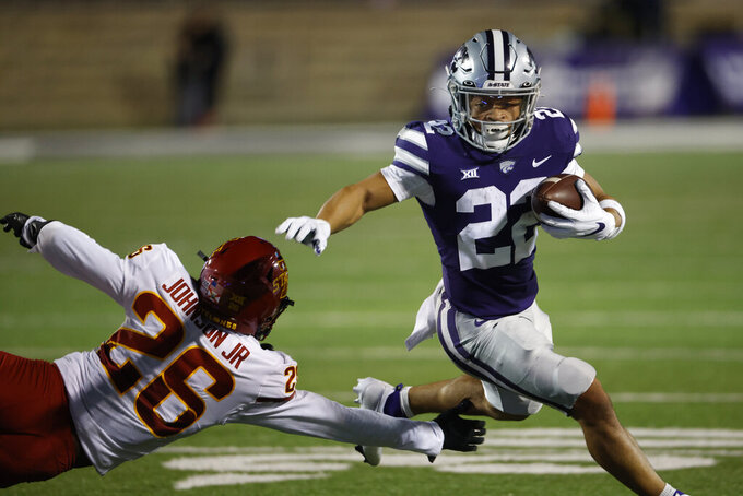 Kansas State running back Deuce Vaughn (22) gets past Iowa State defensive back Anthony Johnson Jr. (26) for a first down during the first quarter of an NCAA football game on Saturday, Oct. 16, 2021, in Manhattan, Kan. (AP Photo/Colin E. Braley)