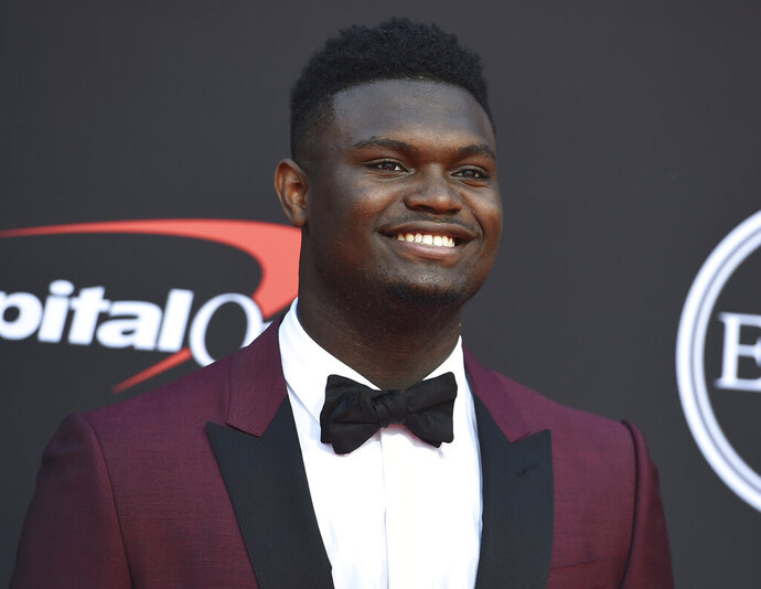 FILE - In this July 10, 2019 file photo, Zion Williamson, of the Duke University Basketball team, arrives at the ESPY Awards at the Microsoft Theater in Los Angeles.  Duke says an investigation has found no evidence that Williamson received improper benefits. School spokesman Michael Schoenfeld said in a statement Saturday, Sept. 7,  that a