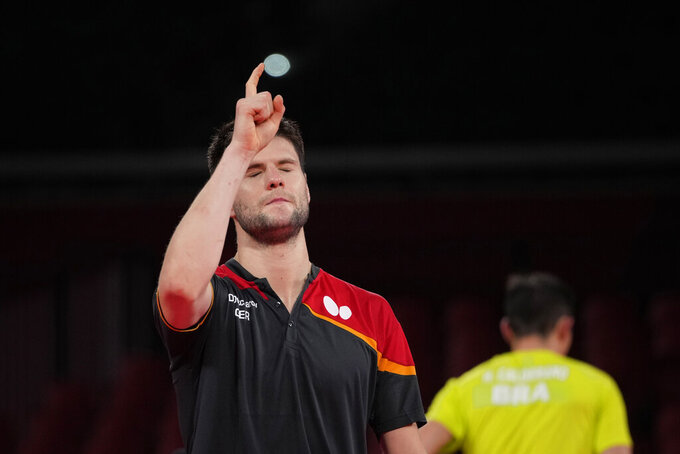 Germany's Dimitrij Ovtcharov reacts after winning the table tennis men's singles quarterfinal match against Brazil's Hugo Calderano at the 2020 Summer Olympics, Wednesday, July 28, 2021, in Tokyo. (AP Photo/Kin Cheung)