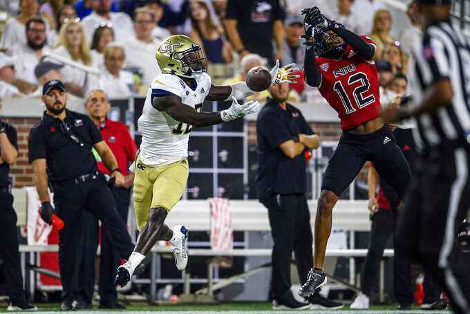 Georgia Tech wide receiver Adonicas Sanders (12) can't make the catch as Northern Illinois cornerback Eric Rogers (12) defends during the first half of an NCAA college football game, Saturday, Sept. 4, 2021, in Atlanta. (AP Photo/Danny Karnik)