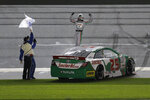 Michael Self, right, celebrates with crew members in front of fans after winning the ARCA auto race at Daytona International Speedway, Saturday, Feb. 8, 2020, in Daytona Beach, Fla. (AP Photo/Terry Renna)