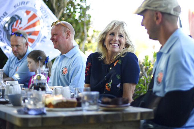 US First Lady Jill Biden meets military surfers and their families in Newlyn, Cornwall, England, on the sidelines of the G7 summit, Saturday June 12, 2021. US First Lady Jill Biden met with veterans, first responders and family members of Bude Surf Veterans, a Cornwall-based volunteer organization that provides social support and surfing excursions for veterans, first responders and their families. (Daniel Leal-Olivas/Pool via AP)