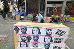 Photos of George Floyd, Breonna Taylor, and Oluwatoyin Sala are shown on a barricade in front of the Seattle Police Department's East Precinct building, Wednesday, June 24, 2020, inside the CHOP (Capitol Hill Occupied Protest) zone in Seattle. Floyd and Taylor died as a result of police violence, and Salau was an activist whose death is being investigated as a possible homicide. The area has been occupied since a police station was largely abandoned after clashes with protesters, but Seattle Mayor Jenny Durkan said Monday that the city would move to wind down the protest zone following several nearby shootings and other incidents that have distracted from changes sought by peaceful protesters opposing racial inequity and police brutality. (AP Photo/Ted S. Warren)