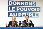 French far-right leader Marine Le Pen, left, and top of the list Jordan Bardella attend a press conference in Henin-Beaumont, northern France, Friday, May. 24, 2019. Polls suggest that Le Pen's party will be among France's top two vote-getters in the election, along with French President Emmanuel Macron's party. Poster behind reads: Give the power to the People. (AP Photo/Michel Spingler)