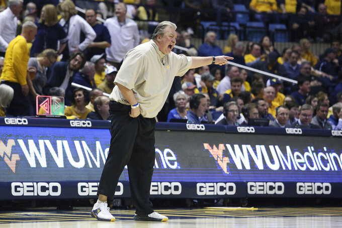 West Virginia coach Bob Huggins reacts to a call during the second half of the team's NCAA college basketball game against Kansas on Wednesday, Feb. 12, 2020, in Morgantown, W.Va. (AP Photo/Kathleen Batten)