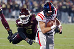 FILE - In this Nov. 28, 2019, file photo, Mississippi quarterback John Rhys Plumlee, right, runs past Mississippi State linebacker Willie Gay Jr. (6) for a 2-yard touchdown dash during the first half of an NCAA college football game in Starkville, Miss. Plumlee is expected to battle with Matt Corral for the starting job to open the season. (AP Photo/Rogelio V. Solis, File)
