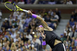 Rafael Nadal, of Spain, serves to Marin Cilic, of Croatia, during the fourth round of the U.S. Open tennis tournament Monday, Sept. 2, 2019, in New York. (AP Photo/Seth Wenig)