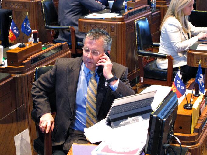 "House Appropriations Chairman Jerome ""Zee"" Zeringue, R-Houma, talks on the phone on the House floor as the Louisiana Legislature reached the final hours of its legislative session, on Monday, June 29, 2020, in Baton Rouge, La. (AP Photo/Melinda Deslatte)"