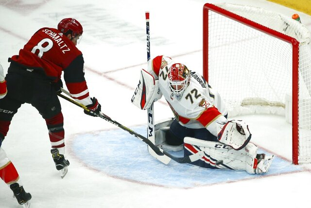 Florida Panthers goaltender Sergei Bobrovsky (72) makes a save on a shot by Arizona Coyotes center Nick Schmaltz (8) during the first period of an NHL hockey game Tuesday, Feb. 25, 2020, in Glendale, Ariz. (AP Photo/Ross D. Franklin)