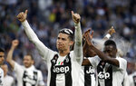 Juventus' Cristiano Ronaldo celebrates with his teammates at the end of a Serie A soccer match between Juventus and AC Fiorentina, at the Allianz stadium in Turin, Italy, Saturday, April 20, 2019. Juventus clinched a record-extending eighth successive Serie A title, with five matches to spare, after it defeated Fiorentina 2-1. (AP Photo/Luca Bruno)