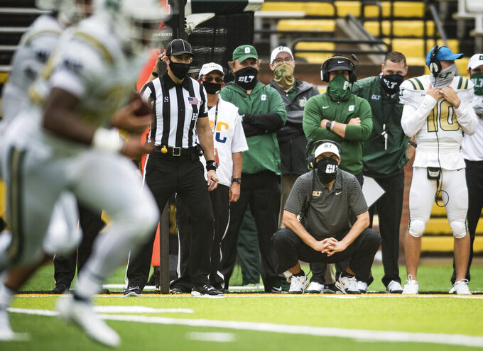 UNC-Charlotte head coach Will Healy watches his team from the sidelines in the second half of an NCAA college football game against Appalachian State, Saturday, Sept. 12, 2020, in Boone, N.C. (Allison Lee Isley/The Winston-Salem Journal via AP)