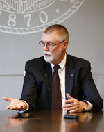 Ohio State University provost Bruce McPheron answers questions during an interview about the accusations against former Ohio State team doctor Richard Strauss Friday, May 17, 2019, in Columbus, Ohio. An investigation found that Strauss sexually abused at least 177 athletes from at least 16 sports as well as others from his work at the student health center and his off-campus clinic. (AP Photo/Jay LaPrete)