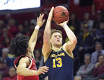 Michigan forward Ignas Brazdeikis (13) shoots as Rutgers guard Geo Baker defends during the second half of an NCAA college basketball game Tuesday, Feb. 5, 2019, in Piscataway, N.J. Michigan won 77-65. (AP Photo/Bill Kostroun)
