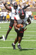 Southeast Missouri State running back Geno Hess, right, rushes for a touchdown in front of quarterback CJ Ogbonna during the third quarter of an NCAA college football game against Missouri, Saturday, Sept. 18, 2021, in Columbia, Mo. (AP Photo/L.G. Patterson)