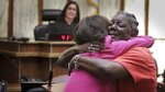 Carmen Brown, right, hugs state Attorney for Miami-Dade County, Katherine Fernandez Rundle after Brown got her right to vote restored during a special court hearing Friday, Nov. 8, 2019, in Miami. The 64-year-old Miami woman, with four felonies on her record from decades ago, was the first person called up at the hearing to restoring felon's voting rights under Florida's amendment 4. (Jose A. Iglesias/Miami Herald via AP)